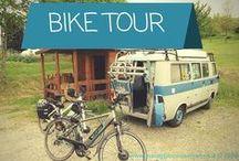 Bike tour / Tour in bicicletta con 2 e-bike e 8 (a volte) il mitico carrellino per bimbi sul quale viaggia nostro figlio Sebastiano.