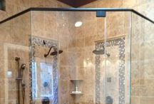 Semi-Frameless Shower Doors / Semi-Frameless Shower Enclosures by Showerman of NJ keeps framing materials to a minimum for a sleeker, clean look.  Semi- Framless shower door framing may be as narrow as one inch wide on the corners and on the doors.  In shower designs with with sliding frameless glass doors, a headrail is used and available in all styles and finishes.  Whether choosing truly frameless or semi-frameless shower enclosures, it will be sure to add beauty to any bathroom, while making cleaning super easy!
