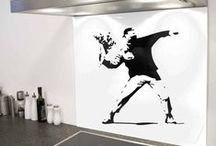 The Banksy Collection / The Banksy collection, a range glass splashbacks designed in the style of iconic street art from Banksy. His satirical street art and subversive epigrams combine dark humour with graffiti executed in a distinctive stencilling technique. Such artistic works of political and social commentary have been featured on streets, walls, and bridges of cities throughout the world. Visit diysplashbacks.co.uk to shop now