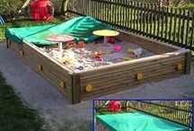 Children's Play Area Ideas / Ideas and materials for children's play areas including child friendly garden surfaces, sand pits, artificial grass, climbing frames and tree houses.