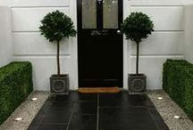 Black Paving Slabs / Patios, paths and driveways featuring black or dark coloured natural stone and concrete paving slabs. #BlackPavingSlabs