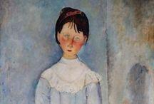 """Amedeo Modigliani (1844-1920) / I ritratti di Modì: volti semplificati, ridotti a poche linee sommarie, colori intensi, pose composte, inquadrature ravvicinate per scavarne, pur attraverso una ricercata deformazione delle figure, la profonda umanità. Tutti  coloro che avevano posato per lui dissero che essere ritratti da Modigliani era come """"farsi spogliare l'anima""""."""