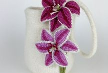 Handmade knitted bags and purses / Unusual and unique, these one-off bags are hand-knitted, felted and individually decorated to produce beautiful works of art that you can wear on your arm. They can be used every day, but also make perfect bridal bags, occasion bags or gifts for someone special.