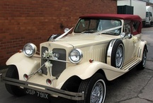 Burgundy Beauford Convertible Wedding Car / A beautiful wedding car and an excellent choice for those who want something extra special on their wedding day The Burgundy Beauford is newly upholstered - with cream leather interior. This vintage wedding car comes in a very light cream and has a deep burgundy convertible roof.