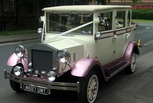 Pink Regal Landaulette Wedding Car / This beautiful car is sure to make you feel like a princess on your wedding day. The Pink Regal Landaulette is the first of its kind anywhere in the whole of the North West. It is also known as the Imperial Wedding Car. These wedding cars seat up to seven passengers and have landaulette roofs, heart shaped back windows and cream leather interiors and roofs. The roof retracts - so your guests can see you arrive in elegance.