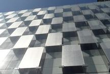 Fashion House HQ, Madrid / One of the world's leading fashion brands welcomes employees and visitors in style with a building façade featuring SEFAR® Architecture Vision at its Madrid, Spain headquarters. The stunning glass curtain wall designed by renowned Spanish architect Rafael de La-Hoz resembles a three-dimensional checkerboard with alternating panels of clear laminated glass and panels embedded with SEFAR Architecture VISION.