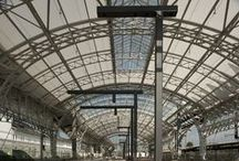 Salzburg Train Station / A recent renovation brings a revitalized look and shopping mall to the Salzburg Central Train Station in Salzburg, Austria. With the help of SEFAR® Architecture's TENARA® Fabric, the station was able to keep its elegant, arched roofing that dates back to 1908 while bringing natural light to the previously dark transit corridors.