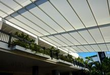 Bal Harbour Shops / Bal Harbour Shops in Miami Beach, FL is superlative in every respect. The prestigious open-air shopping mall has the highest sales per square foot of any shopping center in the world. It features the finest retail establishments in a setting that epitomizes luxury. The latest addition to that setting is a retractable fabric canopy built using SEFAR Architecture® TENARA® Fabric.