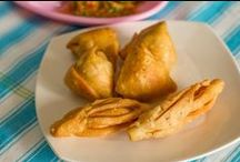 Samosa recipe – served with Indian Salsa (Mother's secret) and Amla (gooseberry) chutney (dip) / Samosa is unarguably the post popular fried snack and millions of them are made and consumed everyday in India. Right from street hawkers, to railway stations, bus stands and airports..you will find Samosa being offered everywhere.