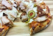 Double cheese pizza-smoked chicken, smoked paprika & olive topping / Smoked Chicken Pizza is very special as I have used smoked paprika cheese for crust filling and smoked chicken breast for topping. The result is authentic wood charcoal flavoured pizza which is very different from an American style pizza.