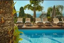 Pool, Hotel Villa Carlotta / From the first sunlight to early evening, relax overlooking the Ionian Sea  / by Hotel Villa Carlotta Taormina