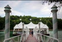 Lanier Islands' Venitian Pier / Draped in white and surrounded on all sides by the tranquil waters of Lanier, this one-of-a-kind venue provides a setting that is truly unparalleled. As the bride descends the boardwalk onto the Pier, it will be a moment that everyone in attendance will remember for years to come (especially her groom). Accommodating ceremonies as large as 175, the Pier will host an entire event, ceremony and reception. Or, dock one of our Yachts here and float away on a reception cruise right from the Pier! / by Lanier Islands Weddings
