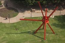 "Mark di Suvero / As an art student, Mark di Suvero explored many other areas of study including architecture, mathematics, science, and structural engineering.  Grounded in abstract expressionism, di Suvero was energized by ""urban renewal"" and the constantly changing landscape of New York City.  With the refuse from demolition sites, he pioneered a new form of sculpture.  ""Clock Knot"" is located between the CPE and ETC buildings at the University of Texas at Austin. GPS: 30.289671,-97.736162 / by Landmarks Public Art"