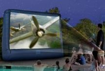 Inflatable movie screen / The drive-in theater may be a fond memory of a bygone era; however, the mystique of outdoor movies is still alive and well. Atlantis Inflatables brings you Movies Under the Stars in your own backyard!