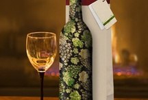 Shop   Wine Bottle Covers / 2012 Wine Bottle Covers - The New Way to Gift Wrap Wine! Features 6 Fashionable and stylish designs. Reusable and washable fabric that stretch to fit 750ml bottles. The perfect housewarming/hostess gift!
