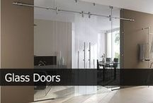 Glass Doors / Glass Hinged doors, glass Sliding doors collection by Creoglass Design. A high proportion of glass elements in houses or flats increases the exploit of light and solar energy, and in addition, heightens the well-being of the residents. However, glass doors can do even more – they alter the aspect of a room in the interaction of natural light with artificial light.