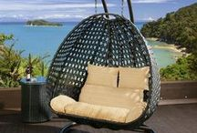 Hanging Rattan Egg Pod Outdoor Chairs / Our hanging chairs are the perfect way to bring a touch of luxury to your garden, patio or decking. Like all our outdoor furniture these chairs come with with our thick super soft cushions and 4 sophisticated colour-ways. Choose from a hanging daybed or a classic egg shape pod chair to while away the hours. All fully fire retardant. These pieces coordinate beautifully with the rest of our garden range so you can build your own exclusive oasis.