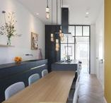 A rooftop gem / Parel op hoogte / By making an open floorplan, a free height of over 3.2 meters and an uninterrupted wooden herringbone floor, the narrow and deep apartment is turned into a light, continuous space.