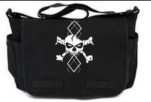Bad Ass Diaper Bags / Finally, cool diaper bags! Our small vintage and large messenger style diaper bags are unique, trendy, and are so much cooler than what you'll find at a typical baby store. Awesome look, awesome quality, awesome diaper bags! Made from durable canvas material with adjustable shoulder straps, all of our totally punk rock bags are sure to please. Fill one with our bottles, pacifiers, and clothes for the perfect punk rock baby shower gift!