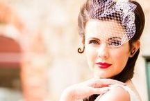 Vintage style bridal hair and make up / Wedding hair and make-up. Victory rolls, waves, curls, birdcages and hair flowers.