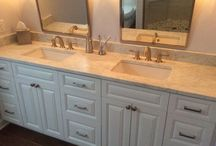 "Master Bathroom / Custom tile, 6""x24"" floor tile, frameless glass, surround, custom double sink vanity, tilt mirrors, triple wall sconces"