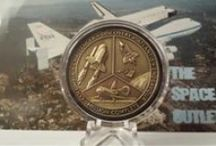 Coins, collections and shiney stuff / Don't collect a lot of coins, but started collecting challenge coins after being awarded a few. Searching for one for my golden shellback husband I run across others in my field too.  / by Laurie Winslow