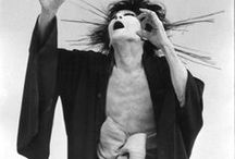 Butoh / Butoh is a Japanese form of dance. It typically involves playful and grotesque imagery, taboo topics, extreme or absurd environments, and is traditionally performed in white body makeup with slow hyper-controlled motion, with or without an audience. There is no set style, and it may be purely conceptual with no movement at all.