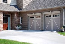Courtyard Collection / Insulated steel construction, fashioned to resemble the elegant wood designs of traditional carriage house doors. The beauty of wood, the durability of steel. Classic designs enhance the architectural beauty of your home. Broad selection of windows and hardware options. Energy-efficient R-value up to 12.76. Up to Limited Lifetime warranty for as long as you own your home.