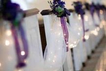 Purples for Weddings / White & Purple flowers line the aisle in a beautiful outdoor wedding.