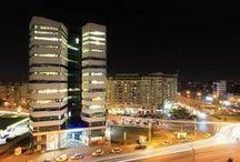 Olympia Tower / Localizata in Bucuresti, intr-o zona centrala in plina expansiune, la intersectia bulevardelor Decebal, Mihai Bravu si Calea Calarasi, cladirea de birouri Olympia Tower are 13 nivele si o suprafata totala construita de 15,500 mp, din care 9,500 mp inchiriabili. Dezvoltatorul proiectului este Bluehouse Capital, iar constructorul este OCTAGON.