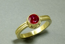 Red is for Rubies / Ruby cabochon with tiny 22k gold leaves and 2pt diamond accent.  Made to order in your size:  http://www.nancytroske.com/product-p/cr515.htm $825