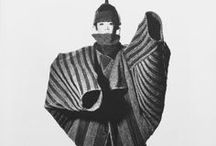 """Irving Penn x Issey Miyake / fashion photographer irving penn was the quintessential american artist. he didn't love fashion as much as he did beauty and found it in the unexpected or unusual. perhaps for this reason, he teamed up with issey miyake to document the avant garde designer's work over a period of a decade. through penn's lens, the clothes read as 3-dimensional and sculptural, and exemplify the phrase, """"wearable art."""" they show what a match made in heaven these two great artists are."""
