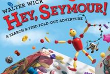 Hey, Seymour! / A new over-size format, search and find, fold-out book starring Seymour, the little bead boy last seen in the Can You See What I See? series, and his new friend, a dog named Buttons.