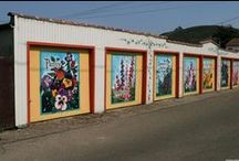 """Murals of Lompoc / """"City of Murals in the Valley of Flowers"""" - Like beautiful flowers blossoming along a vine, Lompoc's mural surprise and delight residents and visitors alike as they stroll the downtown area. Lompoc has over 32 major commissioned murals painted by noted artists, as well as an additional 40 murals, all located in Lompoc's historic old town area."""