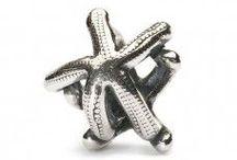 TROLLBEADS / TROLLBEADS rappresenta una delle realtà internazionali più attive e prestigiose.  Oro, argento, vetro, cristalli, diamanti, perle, ambra e pietre preziose. Scegliendo tra più di 500 pezzi, ogni beads e ogni bracciale diventa così unico e inventato da chi lo indossa
