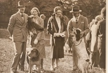 Puppy love / Well-heeled pet owners with their pampered pooches, c.1935, Sam Hood.