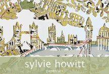 sylvie howitt papercuts / Hand cut paper cut on vintage maps on music sheet