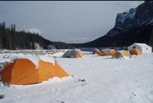 Cold Weather Camping Gear / Cold weather camping gear from tents to sleeping bags. There is nothing better than the pristine outdoors with the snow draped over the tree branches as you snowshoe or cross country ski in the wilderness.