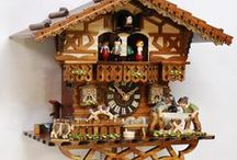 German Cuckoo Clock / A German Cuckoo Clock comes mainly from the Black Forest Region where they are hand carved and often include animals, birds, leaves and traditional scenes besides the traditional bird that pops out announcing the time.