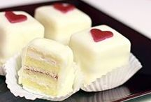 """Cakes > Petit Fours xo / A petit four is a small confectionery or savoury appetizer. The name is French, petit four, meaning """"small oven"""". Typically made with marzipan, they are a very small fancy cake, biscuit, or sweet and served after a meal. But, today they are offered at all kinds of gatherings such as high tea & cocktails & you'll see that marzipan is not typical on this board.  Keva xo."""