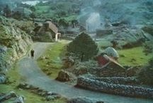 """Ireland༺♥༻ /    """"When I come out on the road of a morning, when I have had a night's sleep and perhaps a breakfast, and the sun lights a hill on the distance, a hill I know I shall walk across an hour or two thence, and it is green and silken to my eye, and the clouds have begun their slow, fat rolling journey across the sky, no land in the world can inspire such love in a common man.""""  ― Frank Delaney, Ireland"""