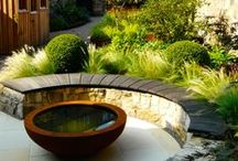 BALI Principal Award-winning Edinburgh New Town Garden / Town garden with rebar raised beds, polished sandstone patio, scorched oak bench, bespoke garden shed, cedec paths, lush planting.  Winner of a Principal Award at the 2014 British Association of Landscape Industries Annual awards ceremony.  Designed by Carolyn Grohmann www.secretgardensdesign.co.uk, built by Water Gems, www.watergems.co.uk.