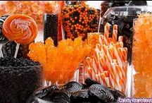 Halloween Theme / Trick-or-Treat! Invite your witches, ghosts and Miley impersonators to enjoy a black and orange candy buffet, complete with creepy treats, Halloween themed cocktails and spooky decorations.