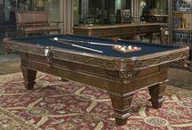 Ambella Home – серьезное отношение к игре / Игровые столы от компании  Ambella Home   выполнены в классическом стиле – они массивны, так как изготавливаются из цельной древесины благородных сортов. Они красивы – украшены резьбой и позолотой. И они, конечно же, чрезвычайно удобны.  Американцы заботятся о комфорте – в бильярдных столах, например, есть специальные выдвижные ящики для хранения необходимого для игры инвентаря.