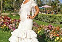 Trajes de flamenca / Galería fotográfica de trajes de flamenca. Fotos de trajes de flamenca. Conoce la historia del traje de flamenca.