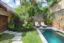 No. 15, 1-Bed Private Pool Villa / 1-bedroom private pool villa withtwin sun-loungers, poolside table, open-air living and dining room, king-sized bed, indoor seating, air-conditioning, indoor-outdoor bathroom, kitchen and luxury hotel services.