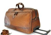 Trolleys. Luggage leather bags on wheels / Leather bags and accessories, made in Italy. Chiarugi, Pratesi, Pellevera
