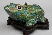 Frog  (art)  objects / Frogs in Asia represent wealth and abundance. Decorating with them, displaying  their little artful items is thought to maintain positive energy & bring prosperity  within our home and family!!!