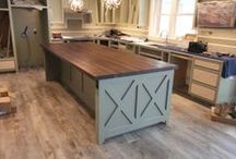 Industrial Kitchen Space with Walnut Butcher Block / High ceilings, cold colors, and large stainless steel appliances can all be warmed up with a walnut butcher block for an inviting kitchen design.