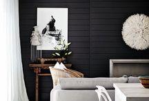 Living room / Black walls White mantel White tile Plants